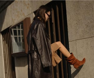 beige, black, and brown boots image