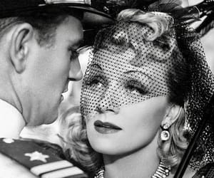 Marlene Dietrich, john wayne, and seven sinners image