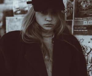 black coat, cap, and jacket image