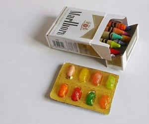 cigarette, pills, and candy image