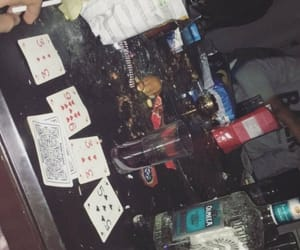 alcohol, cards, and party image