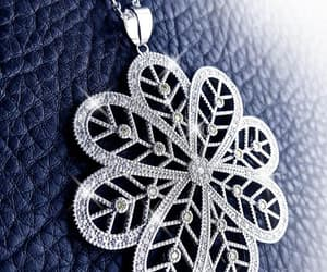 crystal necklace, flower necklace, and sweater necklace image