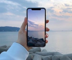 iphone, sea, and sky image