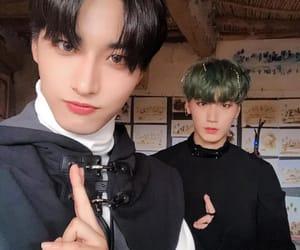 seonghwa, ateez, and san image