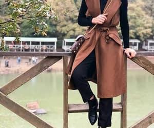 tan vest hijab image