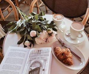 flowers, coffee, and croissant image