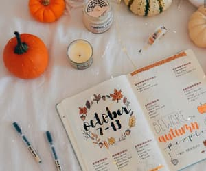 candle, fall, and journaling image