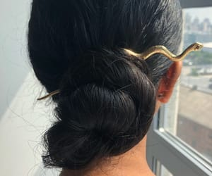 brunette, bun, and hairstyle image
