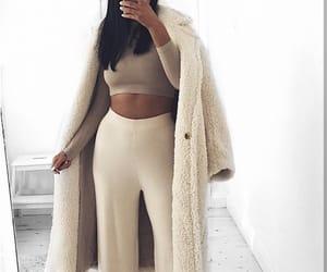 beautiful woman, black hair, and coat image