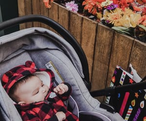 baby, flannel, and flowers image