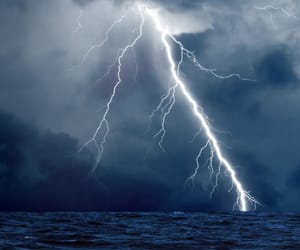 sea, blue, and lightning image
