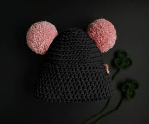 black, powder pink, and double pom pom hat image