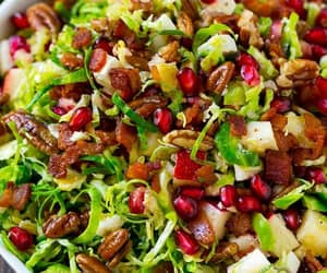 apples, brussel sprouts, and pomegranate image