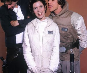 Harrison Ford, Carrie Fisher and Mark Hamill messing around (late 1970s).