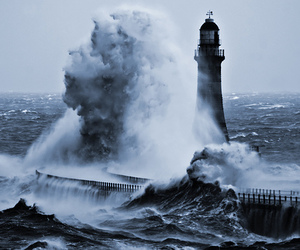 sea, waves, and lighthouse image