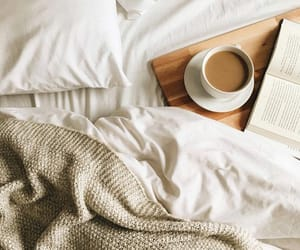 bed, sheets, and book image