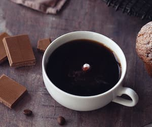 coffee beans, cup of coffee, and muffins image