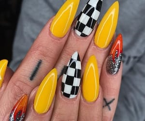 nails, yellow, and fire image