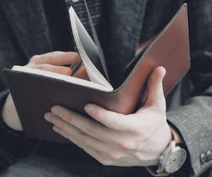 book, hands, and journal image