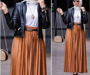 jacket and pleated skirt image