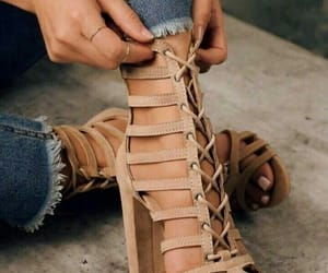 camel, heels, and jeans image