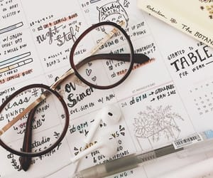 glasses and handwriting image