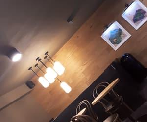 cafe, chandelier, and indoor image
