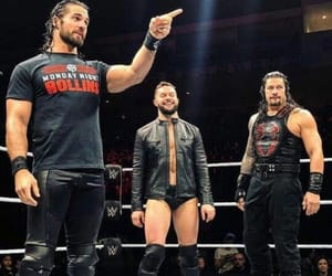 seth rollins, roman reigns, and finn balor image