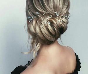 up do, romantic hair, and twist up image