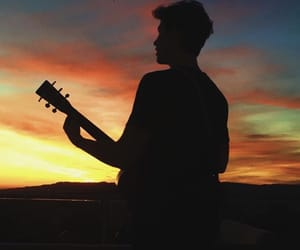 boy, singer, and sunset image
