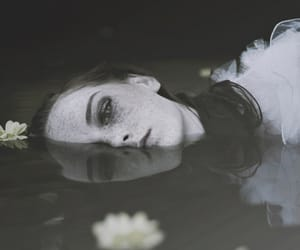 girl, water, and flowers image