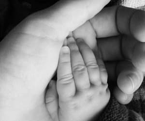 black and white, family, and hands image
