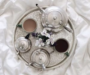 article, books, and tea image