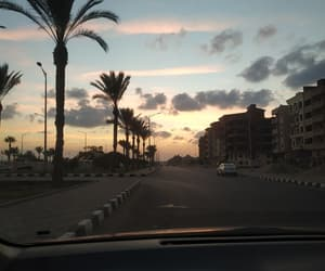 car, clouds, and palm trees image