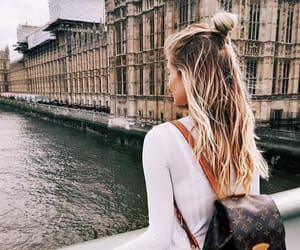 bag, blond hair, and city image
