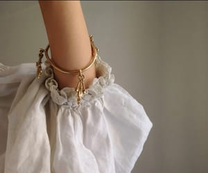 gold, white, and bracelet image