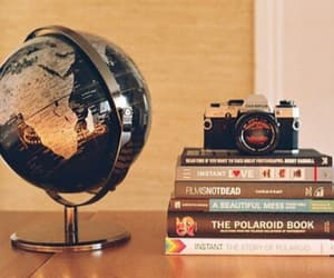 book, camera, and world image