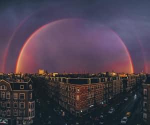 sky, rainbow, and city image