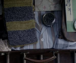 clock, film, and scarf image