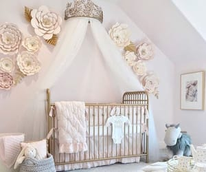 This nursery is so EXTRA! But isn't that the point? It's lovely and will convert well as the child gets older. Great way to make everything look neat. Too much? Take away the flowers from the wall for a cleaner look.