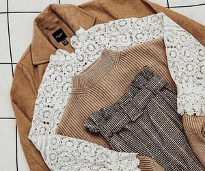 sweater, lace blouse, and camel coat image