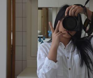 bathroom, camera, and mirror image