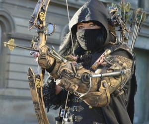 bow and arrow, gears, and warriors image