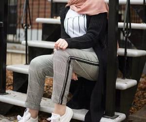 hijab, checked pants, and checked blazer image