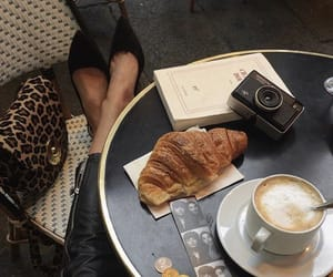 book, camera, and coffee image