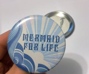 buttons, mermaid, and mirrors image