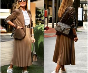 sweater and pleated skirt image
