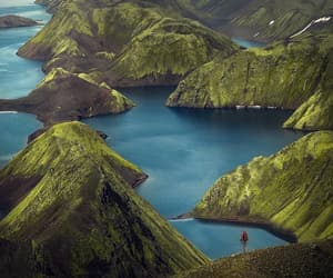 cliffs, grass, and fjord image