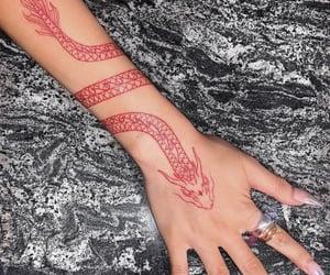 hand tattoo, red tattoo, and tattoo image