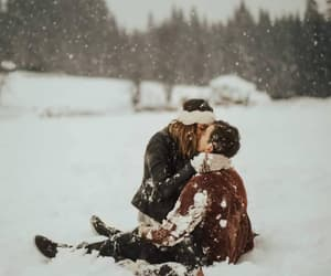 snow, couple, and kiss image